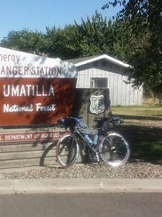 Jared Fenstermacher rides his bicycle on a 3,000 mile