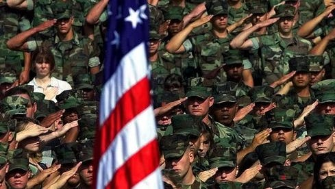 U.S. Marines saluting American flag