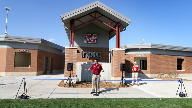 Muskego-Norway School Board President Rick Petfalski greets guests to a opening ceremony on Sept. 22 for the new concession, ticket and restroom facilities built on the south end of the Muskego High School stadium. The project is the first of three development phases at the stadium that include improving seating and artificial turf.