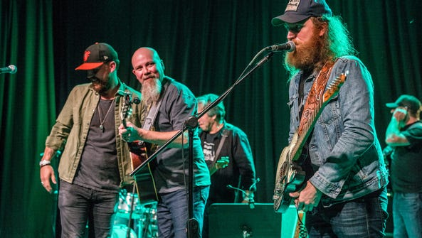 Members of Brothers Osborne join Kendell Marvel, second