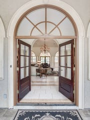 Guests are greeted by stately arches, columns and soaring