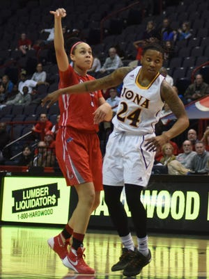 Marist College's Sydney Coffey follows through on a jumper as Iona's Joy Adams begins to box out during Sunday's game at the Times Union Center in Albany.
