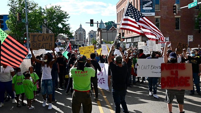 Hundreds of protesters march down State Street in downtown Rockford on Saturday, May 30, 2020, in response to the death of George Floyd, who was killed when a Minneapolis police officer knelt on his neck.