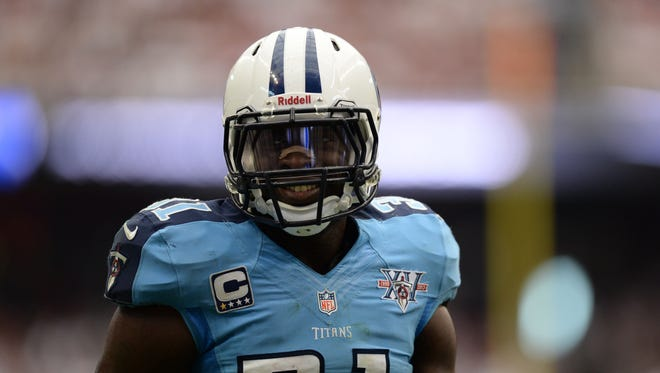 Tennessee Titans strong safety Bernard Pollard (31) smiles as fans taunt him after he injured Houston Texans wide receiver Andre Johnson (80) (not pictured) during the second half at Reliant Stadium. The Texans won 30-24.
