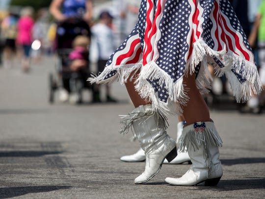 Members of the Cruisin' USA Line Dancers perform during the annual Bologna Festival Friday, July 29, 2016 in Yale.
