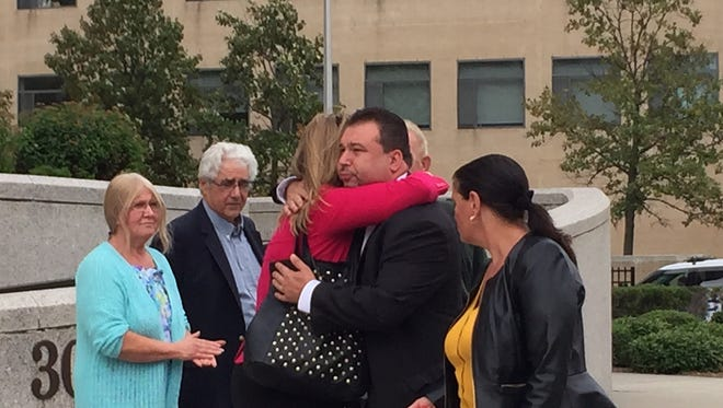Jeffrey Deskovic meets with family and friends outside federal court in White Plains. At left are Mollie and Larry Bria, mother and stepfather of Anthony DiPippo, convicted in 1997 of murder.