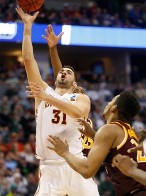 Iowa State forward Georges Niang (31) gets the layup over Iona Thursday, March 17, 2016, during their first round game at the NCAA men's basketball tournament at the Pepsi Center in Denver.