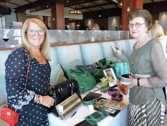 Andi Brennan, left, of vendor Beirn Bags, and customer
