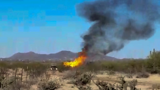 Authorities say the hot air balloon carrying 13 people crashed and caught fire next to a dirt road in the desert igniting a small brush fire but causing no injuries. It's not immediately known what caused the Wednesday morning crash.