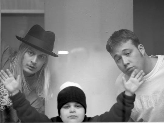 Kid Rock, Joe C and Uncle Kracker do some late-night goofing around at the White Room Studios in Detroit in 1996.