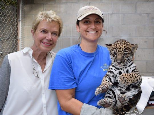 Donor Donna MacMillan, left, bid on the chance to name the new jaguar cub Mema.