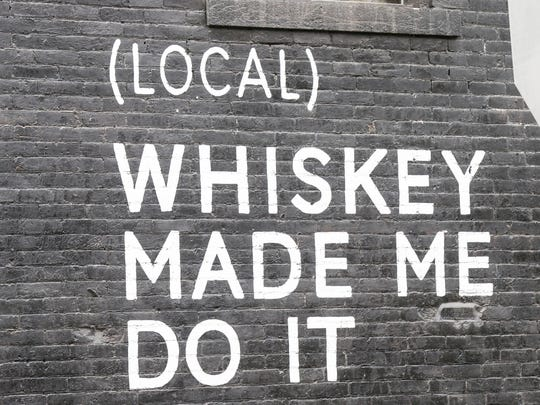 A mural decorates the side of  West Fork Whiskey Co.
