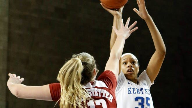 Kentucky's Alexis Jennings (35) shoots while defended by Alabama's Nikki Hegstetter (13) during an NCAA college basketball game Thursday, Jan. 7, 2016, in Lexington, Ky. Kentucky won 73-48.