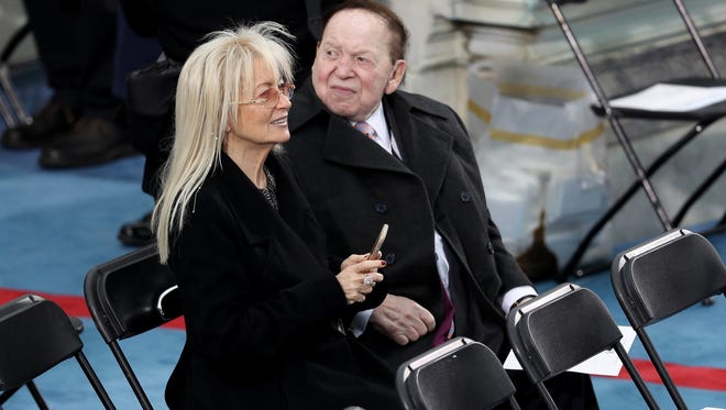 Sheldon Adelson sits on the West Front of the U.S. Capitol on Friday to witness Donald Trump's inauguration.
