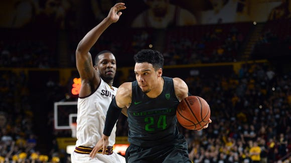 Jan 31, 2016; Tempe, AZ, USA; Oregon Ducks forward Dillon Brooks (24) drives against Arizona State Sun Devils forward Willie Atwood (2) during the first half at Wells-Fargo Arena. Mandatory Credit: Joe Camporeale-USA TODAY Sports