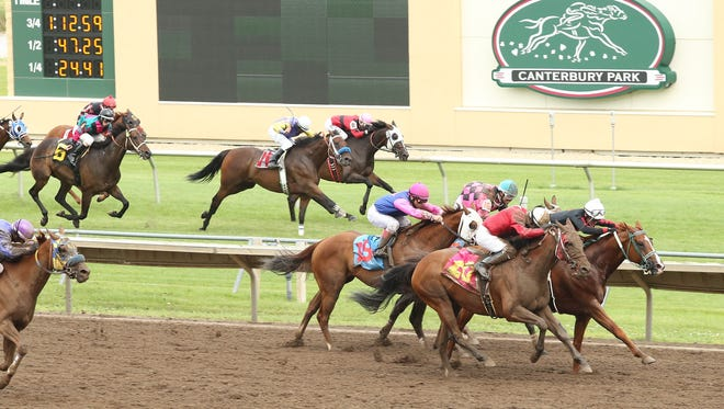 """Saturday's """"Battle of the Surfaces"""" at Canterbury Park."""