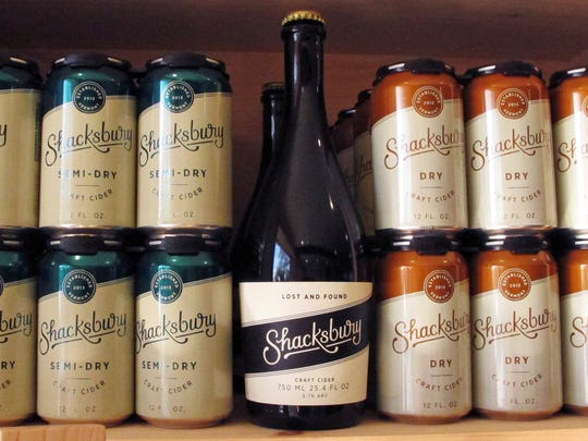 In this Oct. 4, 2017, photo, a display of Shackbury Cider's beverages sits on a shelf at the company's tasting room in Vergennes, Vt. Shacksbury Cider in Vergennes, Vermont, harvests wild apples from mountain roadsides, old farmsteads and pastures and the backyards of homes through its Lost Apple Project. It produces specialty hard ciders from the harvests and propagates its own trees from some of the best wild ones.