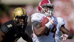 Alabama running back Damien Harris (34) carries on