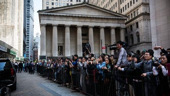 Media and fans of Alibaba Group wait outside the New York Stock Exchange while executives of the company leave the building after the company's IPO debut on September 19, 2014 in New York City.