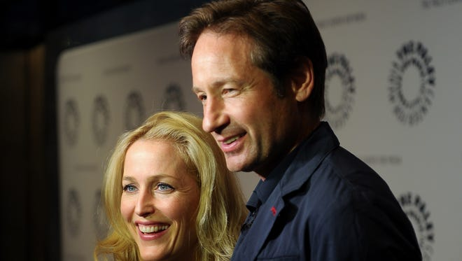 """Gillian Anderson and David Duchovny at an """"X-Files"""" panel in 2013 in New York City."""
