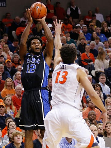 Duke Blue Devils forward Justise Winslow (12) launches