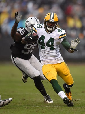 Green Bay Packers running back James Starks (44) runs with the ball against the Oakland Raiders at O.co Coliseum.