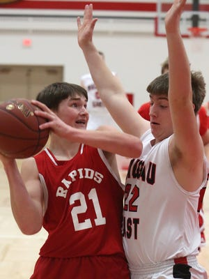 Wisconsin Rapids' Alex Bassuener gets ready to go up for a shot while being gurarded by Wausau East's Ben Schubring as the Red Raiders beat East at East, 56-42, Tuesday, December 9, 2014.