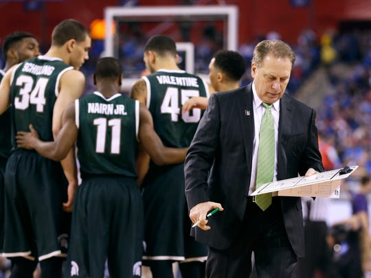 Michigan State head coach Tom Izzo walks back to the bench during the second half of the NCAA Final Four tournament college basketball semifinal game against Duke Saturday, April 4, 2015, in Indianapolis.