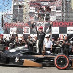 FILE -- Josef Newgarden is excited after taking the provisional pole during Pole Day at the Indianapolis Motor Speedway on Sunday, May 18, 2014.