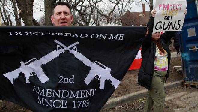 Counter-protesters in favor attend the March for Our Lives rally on March 24, 2018 in Chicago.