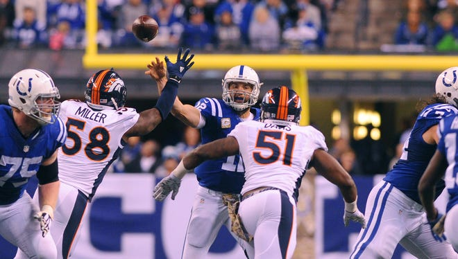 Indianapolis Colts quarterback Andrew Luck (12) throws the ball upfield for a completion during the second half of an NFL football game Sunday, Nov. 8, 2015, at Lucas Oil Stadium. The Colts won 27-24.