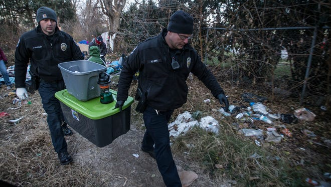 "Byron ""Roc"" Peeler is removed from a homeless camp between Jefferson Street and I-65 by Metro Louisville police officers. Dec. 8, 2017."