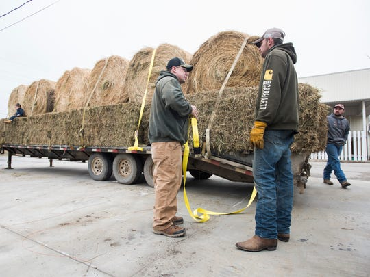 Volunteers get their trucks ready Sunday, Mar. 26, before departing Croswell for Kansas for a farmer relief effort.