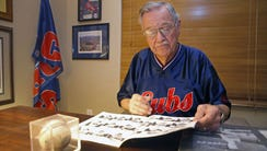Herman Blote looks over some of his Chicago Cubs memorabilia