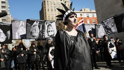 People attend a rally and a mock funeral for the presidency