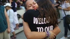 Emma Gonzalez is hugged as she joins other people after