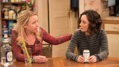 Lecy Goranson as Becky and Sara Gilbert as Darlene