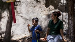 Miria Maradiaga, 40, of Honduras, plays with her son,