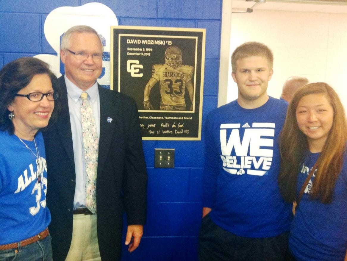 A dedication ceremony in honor of the late David Widzinski was held Monday at the Detroit Catholic Central High with (from left) parents Barb and Paul, along with brother Stephen and sister Emily on hand for the plaque unveiling.