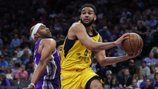 Indiana Pacers guard Cory Joseph (6) passes the ball against Sacramento Kings guard Vince Carter.