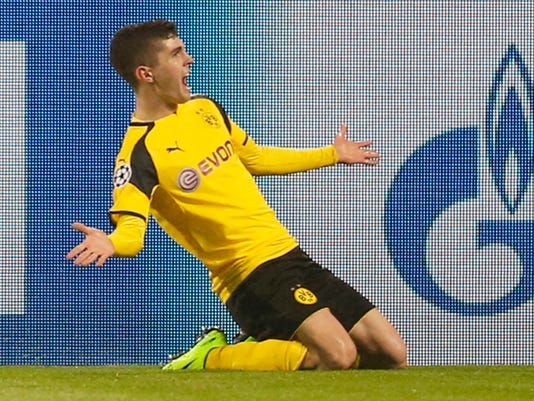 Dortmund's Christian Pulisic celebrates after scoring his side's second goal during the Champions League round of 16, second leg, soccer match between Borussia Dortmund and Benfica in Dortmund, Germany, Wednesday, March 8, 2017. (AP Photo/Michael Probst)