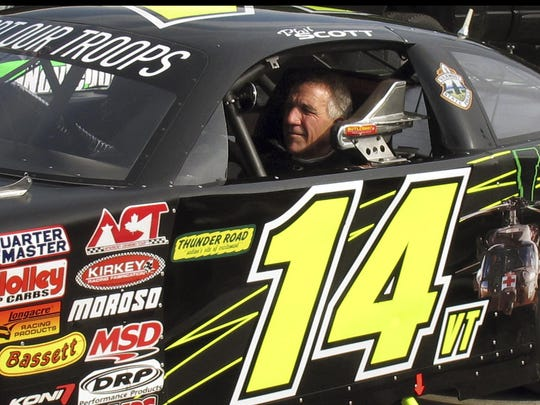 Vermont Gov. Phil Scott waits to take his stock car out for a practice run at the Thunder Road race track in Barre in 2017.
