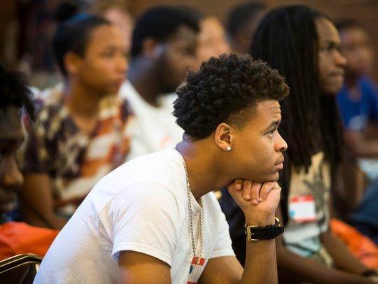 "Participants in Knoxville's third annual Save Our Sons Summit listen as former UT Vol football player Sterling ""DJ Sterl the Pearl"" Henton gives a keynote address at Pellissippi State's Magnolia Ave. campus on Friday, June 29, 2018."