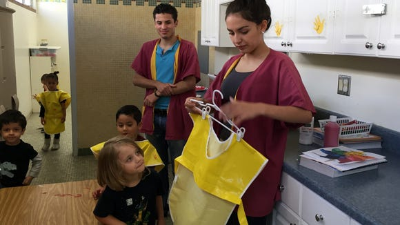Andress High School students help preschool children attending the Child Development Lab on the Andress campus.