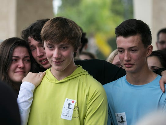 Students gathered with family and friends of Erik Babatz