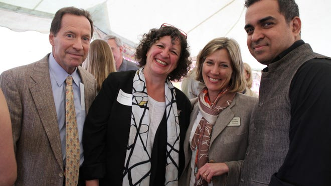 """The Olana Partnership board Chairman Rick Sharp, Trustee Meredith Kane, President Sara Griffen and fashion designer Bibhu Mohapatra pose at the opening reception for """"All the Raj"""" on May 11. The exhibit will be open until Nov. 2."""