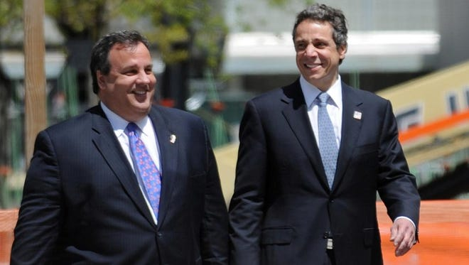 """CAPTION CORRECTION - NAME (R) US President Barack Obama (C) walks with New Jersey Governor Chris Christie (L), New York Governor Andrew Cuomo (2nd L), New York Mayor Michael Bloomberg (2nd R) and Port Authority Chairman David Samson (R) before laying a wreath at the 9/11 Memorial at Ground Zero in Lower Manhattan May 5, 2011 in New York. Obama took a defiant message to the New York epicenter of the 9/11 attacks Thursday, warning that Osama bin Laden's death proved America will never fail to bring terrorists to """"justice."""" AFP PHOTO/Stan HONDA (Photo credit should read STAN HONDA/AFP/Getty Images)"""