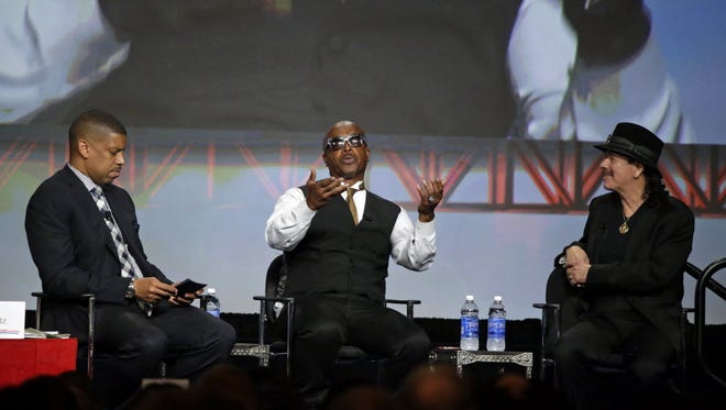 From left, Sacramento, Calif., Mayor Kevin Johnson, MC Hammer and Carlos Santana, hold a question-and-answer session before President Obama spoke to the U.S. Conference of Mayors on June 19, 2015, in San Francisco.