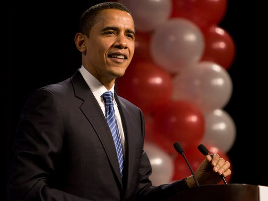 Sen. Barack Obama takes the stage at Democratic Party of Wisconsin Founders Day Gala in Milwaukee on Feb. 15, 2008.