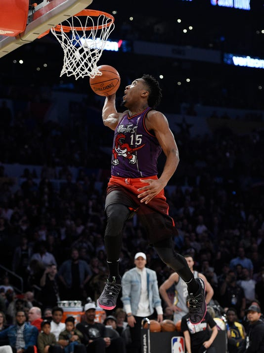 Utah Jazz's Donovan Mitchell competes in the NBA basketball All-Star weekend slam dunk contest Saturday, Feb. 17, 2018, in Los Angeles. Mitchell won the event. (AP Photo/Chris Pizzello)